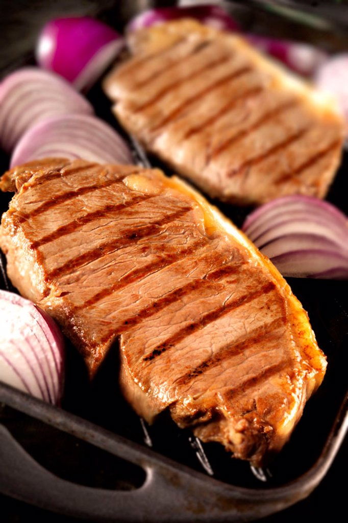 Stock Photo: 1898-5054 Sirloin steaks with red onions