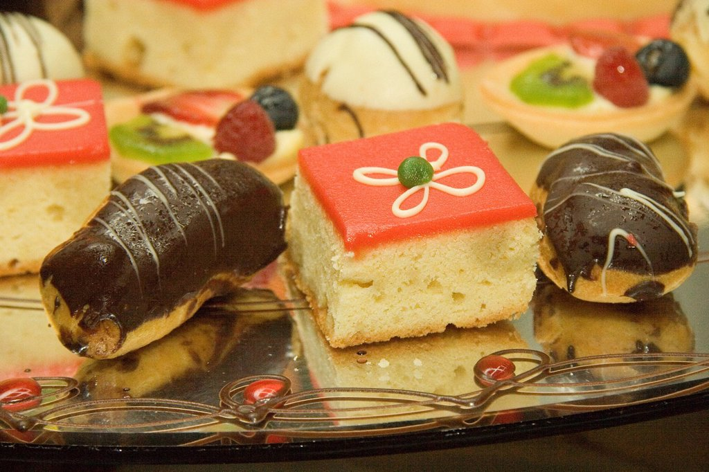 mini cakes and pastries on the dessert buffet of a cruise ship : Stock Photo