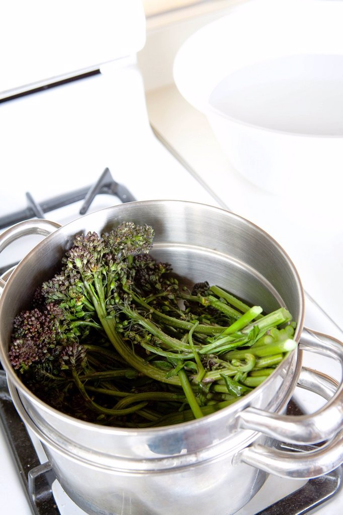 Stock Photo: 1898-51065 Steaming purple sprouting broccoli to add to a pasta dinner _ with recipe