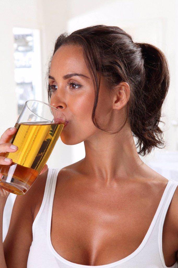 Stock Photo: 1898-51336 Woman Drinking Apple Juice