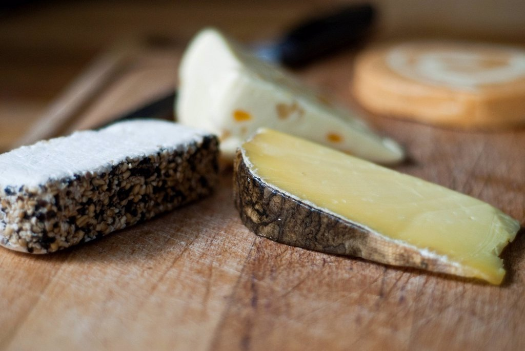 Selection of Cheeses on a cheese board : Stock Photo