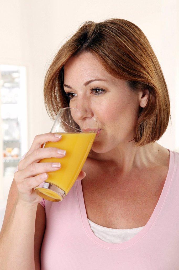 Woman Drinking Orange Juice : Stock Photo