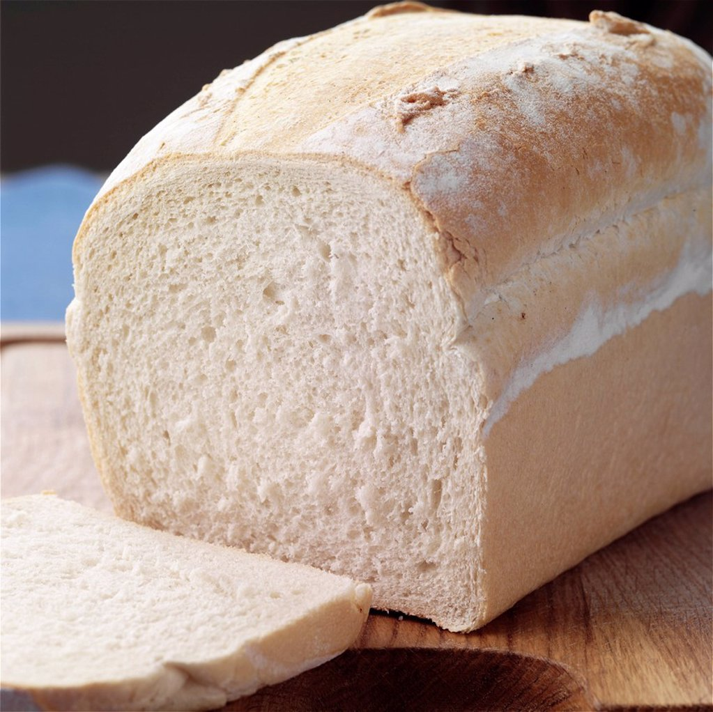 Stock Photo: 1898-52471 Slice and Loaf of white bread