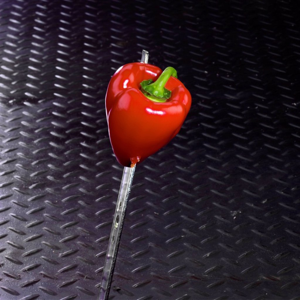 Red Pepper Impaled on a Blade : Stock Photo