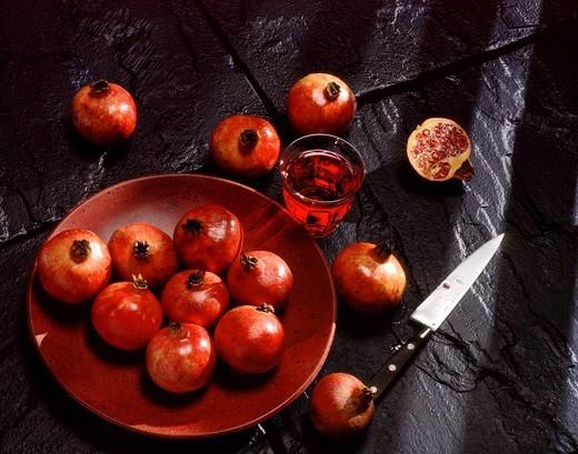 Red pomegranates and pomegranate juice : Stock Photo