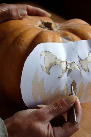 Pumpkin carving step shot : Stock Photo