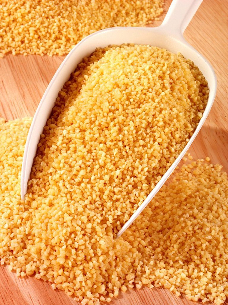 Stock Photo: 1898-57719 Couscous in Scoop - Non Exclusive