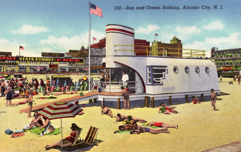 Sunbathing at Beach. ca. 1943, Atlantic City, New Jersey, USA, 102-Sun and Ocean Bathing, Atlantic City, N.J. Surf bathing, the finest in the world, on a gradually sloping, safe, golden-sanded beach, is enjoyed by Atlantic City's millions from May to October. Several splendid indoor salt water pools provide year- round bathing.  : Stock Photo