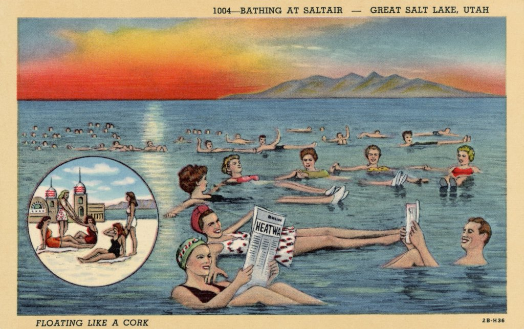 Stock Photo: 1899-10458 Swimmers Floating in Great Salt Lake. ca. 1942, West of Salt Lake City, Utah, USA, 1004-BATHING AT SALTAIR-GREAT SALE LAKE, UTAH. FLOATING LIKE A CORK. 18 miles west of Salt Lake City, Utah, is an inland sea covering an area of 2,000 square miles-75 miles long with a maximum width of 50 miles. It contains a higher percentage (21%) of common salt than any other large body of water in the world. Bathers enjoy the exhilarating experience of swimming in its water, so buoyant that it is impossible to