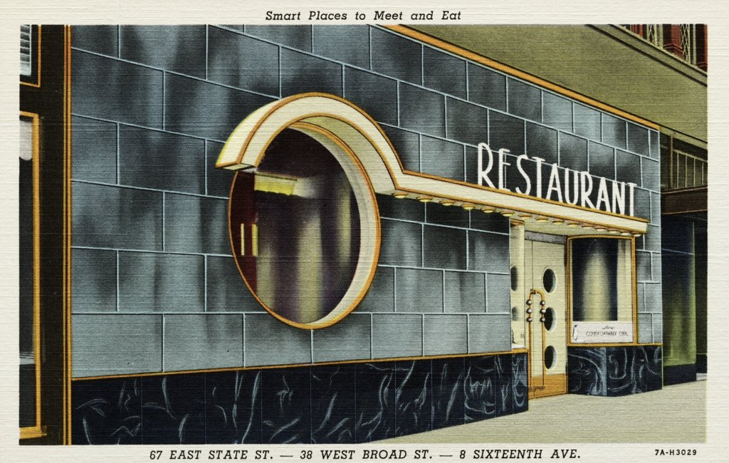 Outside a Restaurant. ca. 1937, Smart Places to Meet and Eat. 67 EAST STATE ST.-38 WEST BROAD ST.-8 SIXTEENTH AVE. Frecher's MALTED MILK SHOPS. BREAKFAST, LUNCHEONS, DINNERS. For Private Parties, Banquets, Clubs. The Brilliant New 'VOGUE ROOM'. 67 East State St. -- ADams 8715  : Stock Photo
