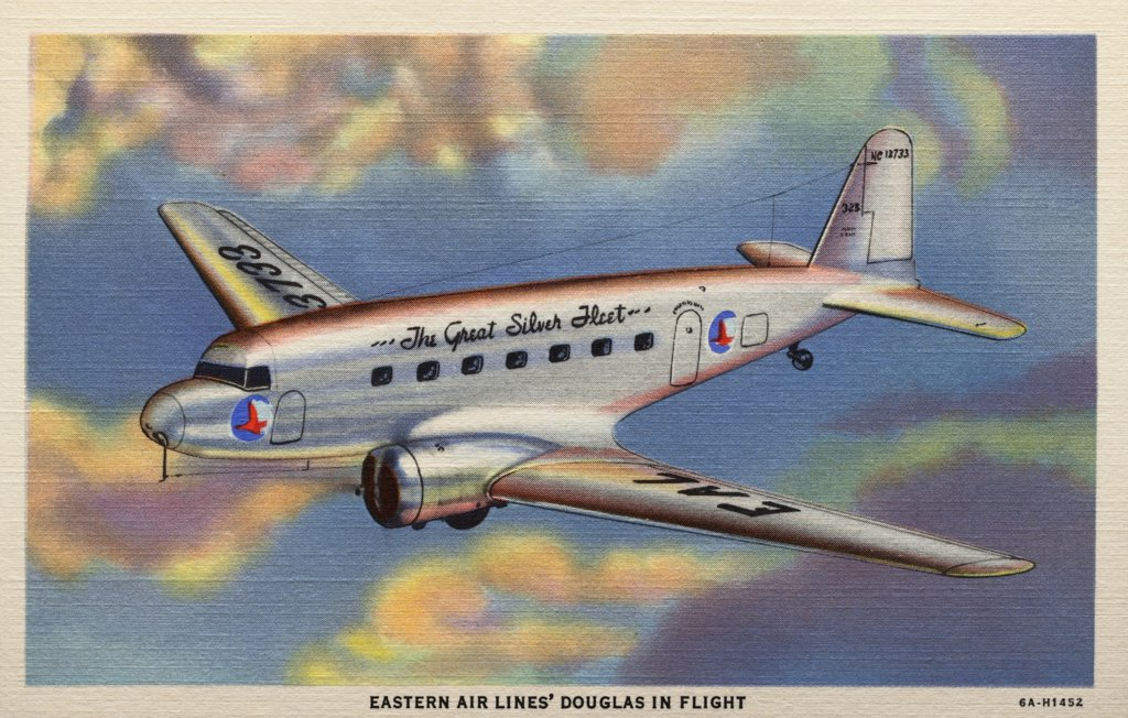Stock Photo: 1899-10923 Eastern Airlines Douglas Plane. ca. 1936, USA, EASTERN AIR LINES' DOUGLAS IN FLIGHT. Travel at three miles a minute in easy-chair comfort is the experience of wise travelers who ride Eastern Air Lines' giant Douglas Transports.