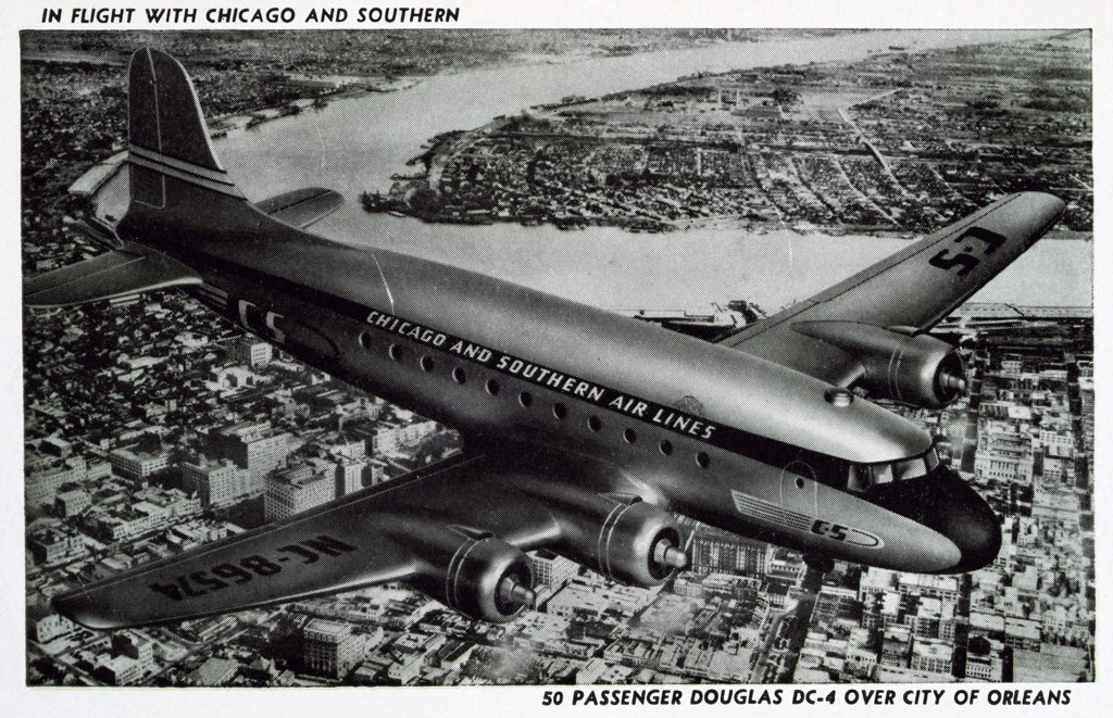 Douglas DC-4 in Flight. ca. 1946, New Orleans, Louisiana, USA, IN FLIGHT WITH CHICAGO AND SOUTHERN. 50 PASSENGER DOUGLAS DC-4 OVER CITY OF ORLEANS  : Stock Photo