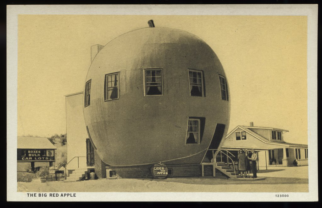 Big Red Apple. ca. 1928, Wathena, Kansas, USA, The Big Red Apple. 30 feet high. HUNT BROS. ORCHARD, WATHENA, KAS. Stop at Miller's Pharmacy for high class Fountain Service.  : Stock Photo