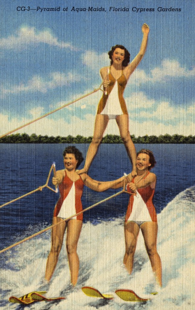 Aqua-Maids at Cypress Gardens. ca. 1949, Florida, USA, It's water skiing time in Florida and here three of the Cypress Gardens Aqua-Maids form a pyramid of beauty while skiing over the water at 30 miles per hour.  : Stock Photo