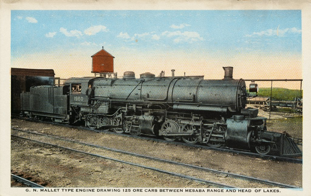 Stock Photo: 1899-11399 Postcard of Train Pulling Ore Cars. ca. 1908-1910, G.N. MALLET TYPE ENGINE DRAWING 125 ORE CARS BETWEEN MESABA RANGE AND HEAD OF LAKES.