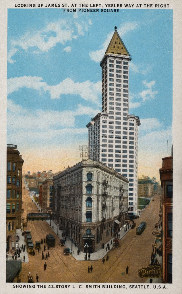 Stock Photo: 1899-11461 Postcard of L.C. Smith Building. ca. 1914, LOOKING UP JAMES ST. AT THE LEFT, YESLER WAY AT THE RIGHT FROM PIONEER SQUARE. SHOWING THE 42-STORY L.C. SMITH BUILDING, SEATTLE, U.S.A. VISIT THE 42-STORY L.C. SMITH BUILDING. The highest and finest and most representative Office Building in the world outside of New York City. Its wonderful Observatory-Chinese Room with hand-carved teak finish and furnishings-replicas of tables from famous Chinese Temples-Bronze Lanterns and gorgeous Oriental Furnishin