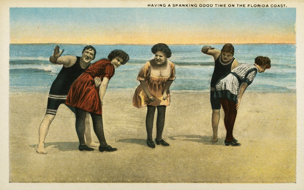 Postcard of Women Being Spanked at the Beach. ca. 1916, HAVING A SPANKING GOOD TIME ON THE FLORIDA COAST.  : Stock Photo