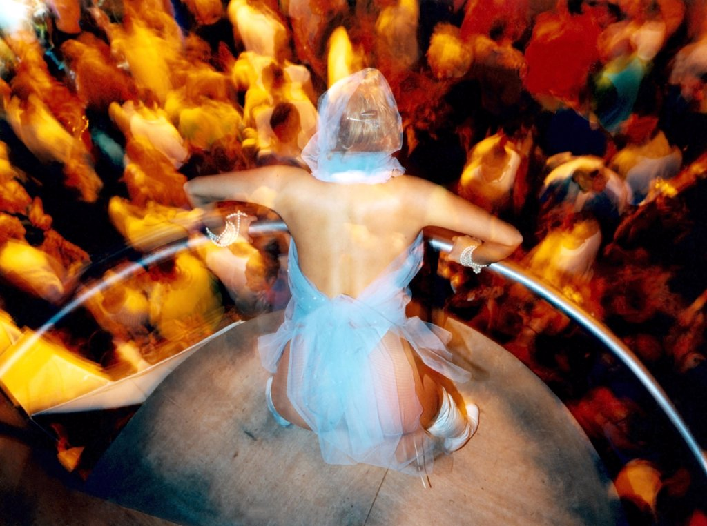 A Dancer on her podium looking down at the crowd Ibiza 1999.  : Stock Photo