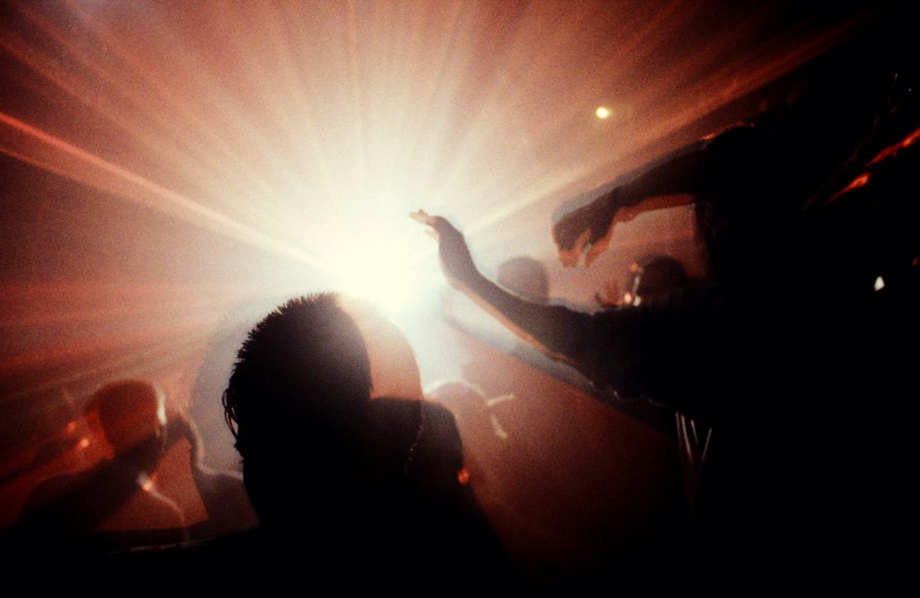 Crowd with lights Megatripolis London UK 1990's.  : Stock Photo