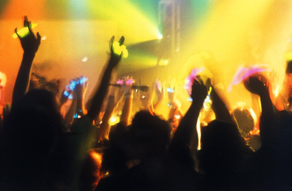 Crowd with hands in the air, clubbing, UK 1997.  : Stock Photo