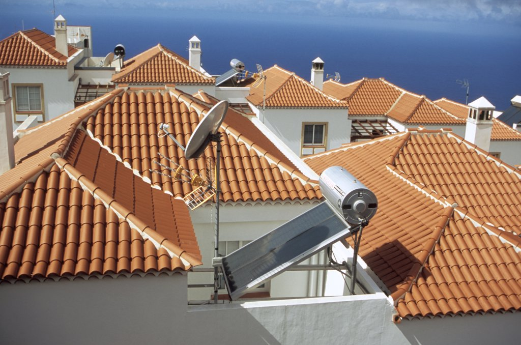 Stock Photo: 1899-21113 Solar panels on roof, Canary Islands. Solar panel, roof , house, South of La Palma. hot water. Village, roof line, terracotta, roof tiles, white washed walls, blue sky, renewable, sustainable, tourism, holiday, resort, responsible, energy,