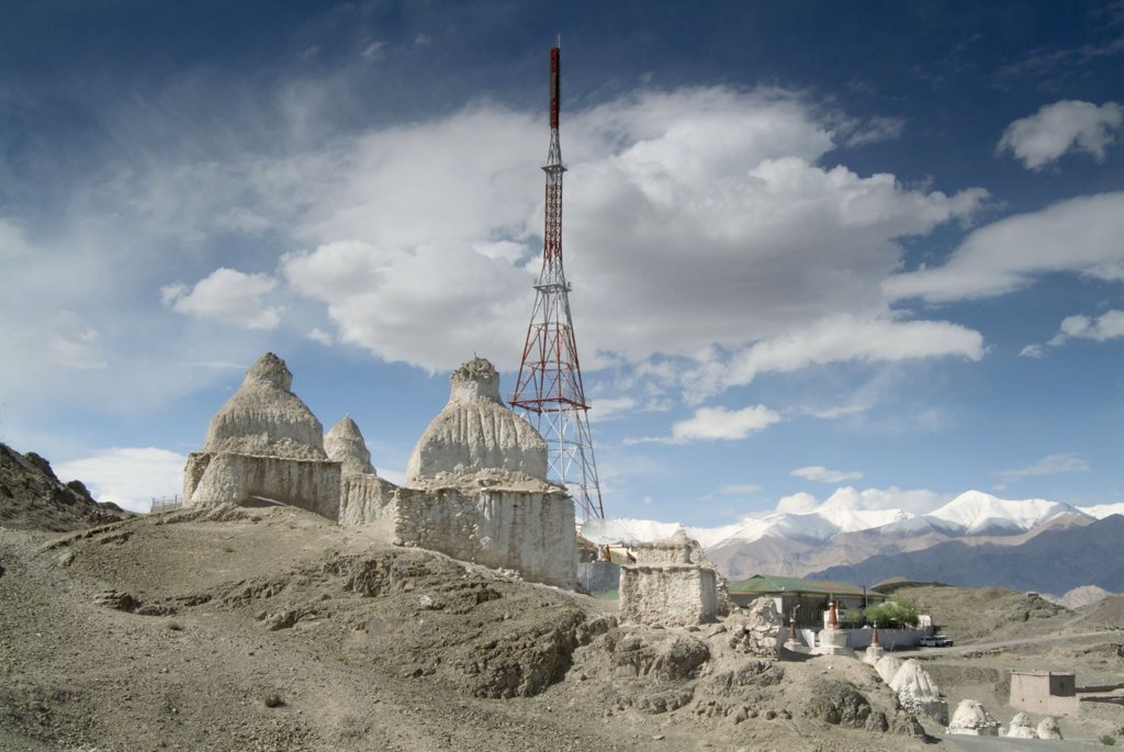 Stock Photo: 1899-21201 TV mast and ancient tibetan buddhist chortens - Stok, Ladakh, Himalayas, India.