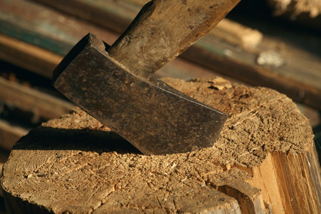 Stock Photo: 1899-21275 Axe in woodblock, wood is used as a fuel for the heating of houses and saunas in Finland because of its plentiful availability.