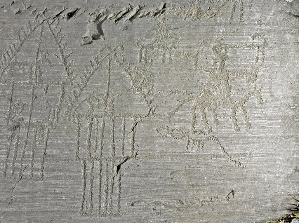 Stock Photo: 1899-24040 Prehistory, Rupestrian Art: Naquane National Park Rock 35 (Brescia). Rock engraved with scenes of village life. Huts, dogs, deer, birds and a man by horse. . Neolithic / Iron Age. Parco nazionale delle incisioni rupestri di Naquane, Capo di Ponte, Italy