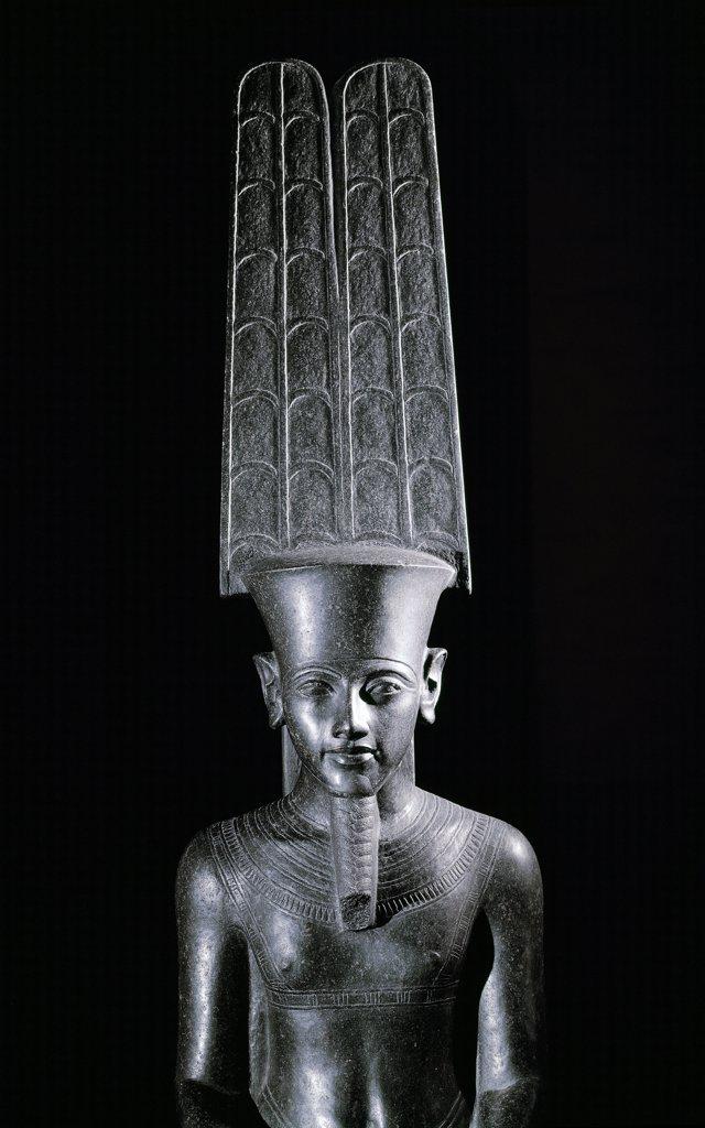 Egyptian Antiquities: Amon protecting Tutankhamun. Black granite, H220 cm, 1336-1327 BC. Musee du Louvre, Paris, France.  : Stock Photo