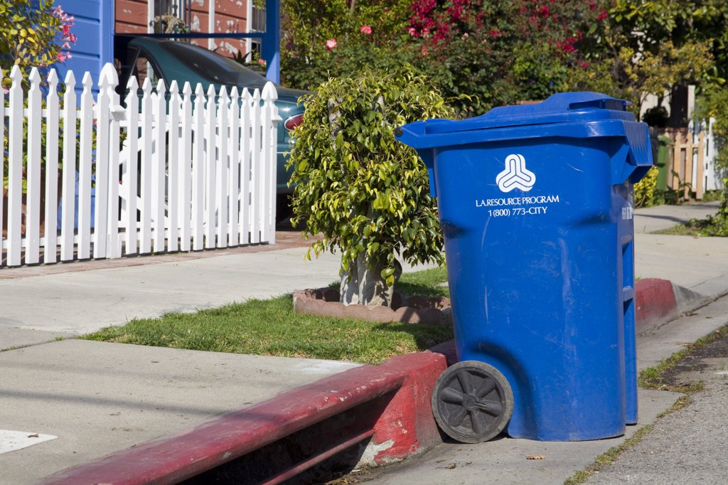 A Blue trash bin for the City of Los Angeles Bureau of Sanitation's Solid Resources Citywide Recycling Program. The program collects refuse, from more than 750,000 homes, an average of 6,652 tons per day. .  : Stock Photo