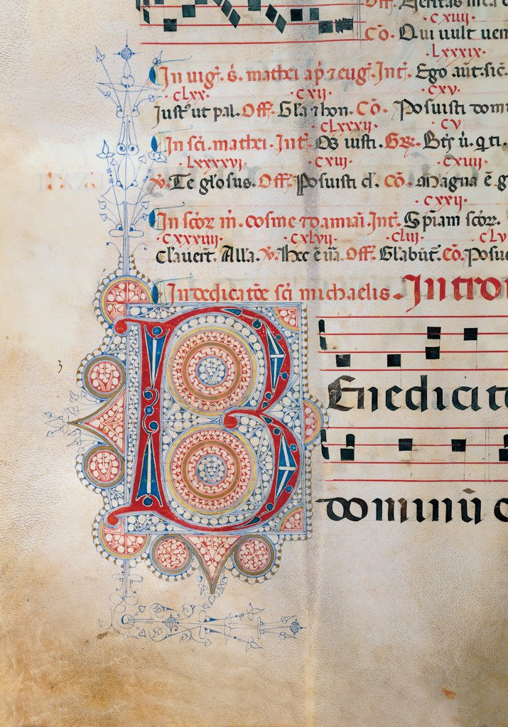 Proprio dei Santi gradual from St Andrew Apostle Eve to the Feast of pope Clement and Comune dei Santi gradual from an Apostle Eve to the dedication of the church, by Anonymous Sienese painter, 15th Century, illuminated manuscript. Italy, Tuscany, Siena, Osservanza basilica. Detail. Benedicite illuminated page score notes text verses prayer chant incipit: beginning initial letter decoration plant volutes rinceaux blue red yellow green. : Stock Photo