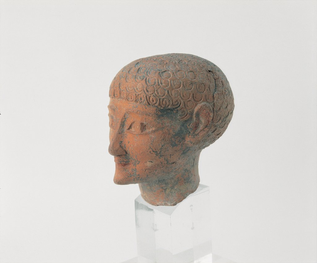 Stock Photo: 1899-30149 Terracotta Head of a Youth, by Unknown, 8th Century, terracotta . Italy, Sardegna, Cagliari, Archaeological National Museum. Whole artwork. Three quarters. Terracotta molded finished burin young man's head oriental features (archaic smile drawn eyes) resembling early Corinthian clay production.