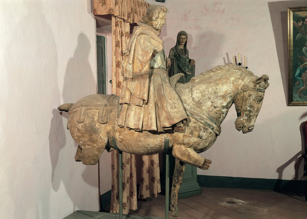 Stock Photo: 1899-30184 St Cassian, by Francesco di Valdambrino, 15th Century, wood carved and polychrome. Italy, Tuscany, Bagni di Lucca, Lucca, St Cassian Parish Church. Whole artwork. St Cassian man horse harness mantle: cloak habit wood carving.