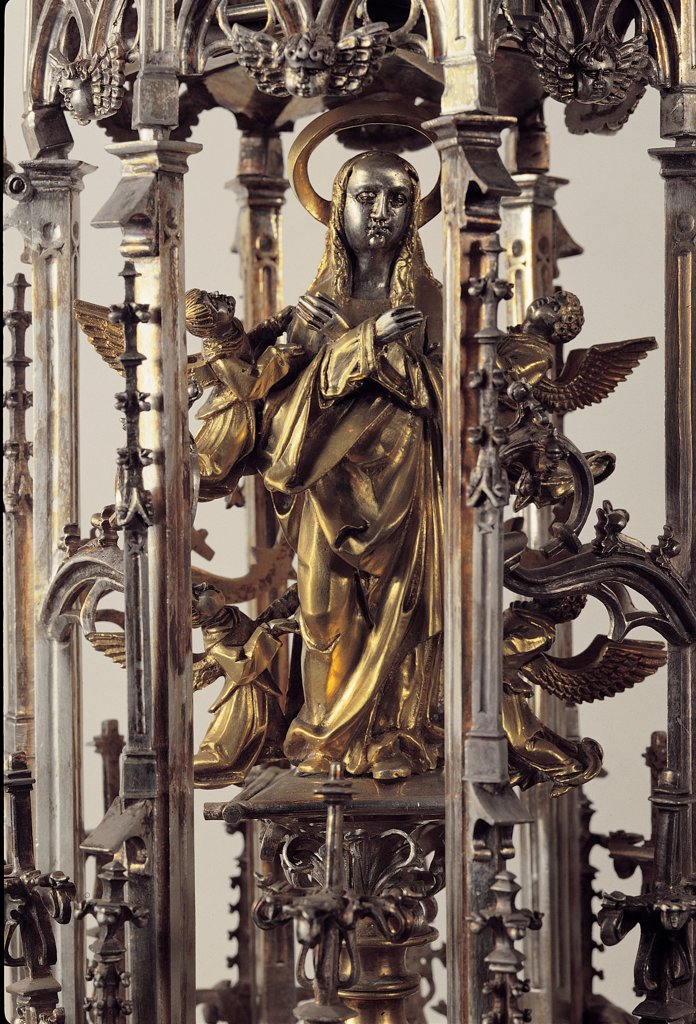 Monstrance, by Unknown, 16th Century, gold and silver . Italy, Lombardy, Gandino, Bergamo, Santa Maria Assunta Basilica, Museum. Detail. Monstrance late-Gothic jewelry female figure in prayer halo: aureole nimbus tunic: habit. : Stock Photo