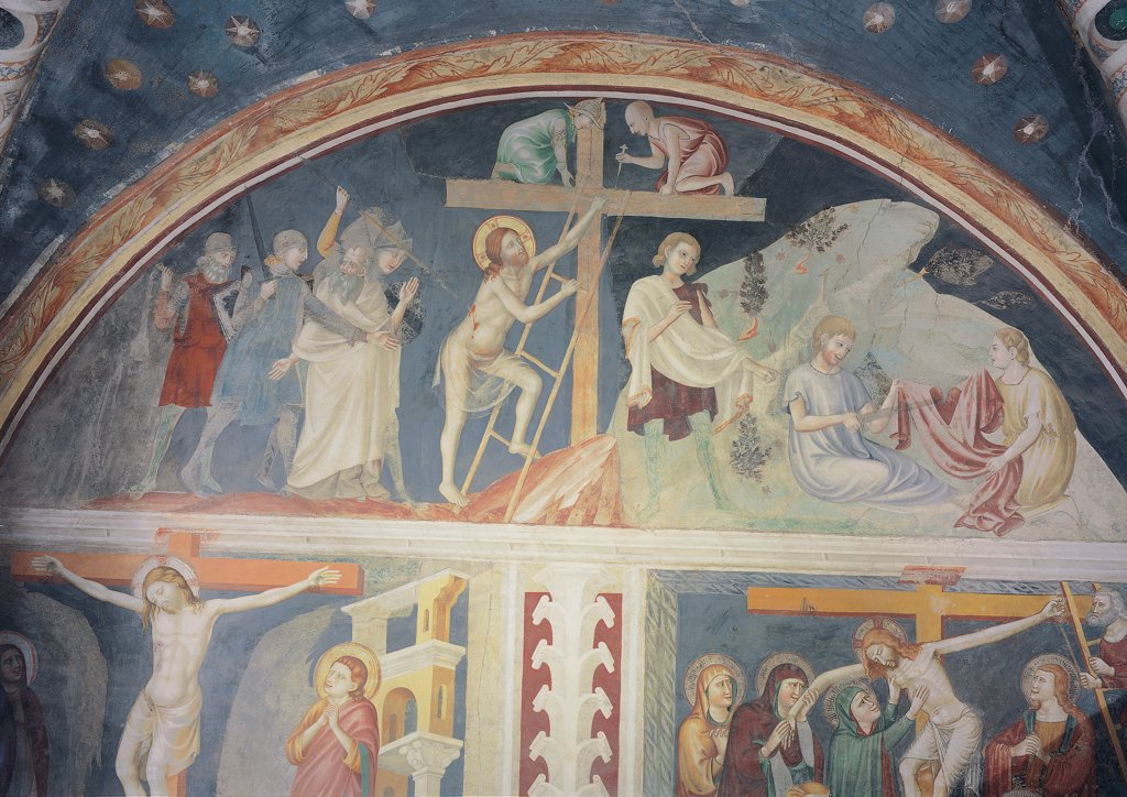 The Crucifixion of Jesus Christ, by Primo Maestro di Sant'Antonio in Polesine, 14th Century, fresco. Italy, Emilia Romagna, Ferrara, Sant'Antonio in Polesine Church. Detail. Christ on the cross lunette order Roman soldiers armors cuirass helmets ladder playing dice garments: robes of Jesus rocks trees blue red white yellow light blue: azure green grey. : Stock Photo