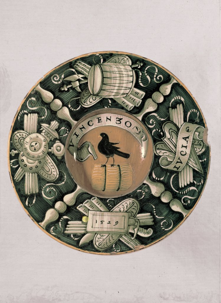 Stock Photo: 1899-30876 Plate with heraldic coat of arms, by Unknown, 1529, 16th Century, pottery. Italy, Emilia Romagna, Faenza, Ravenna, International Museum of Ceramic. Whole artwork. Plate decoration coat of arms raven on barrel around panoplies cartouche with inscriptions.