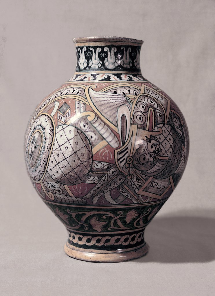 Pharmacy pitcher, by Unknown, 16th Century, pottery . Italy, Emilia Romagna, Faenza, Ravenna, International Museum of Ceramic. Whole artwork. Vase globular shape lip distinct intertwined decoration panoplies decorative bands. : Stock Photo