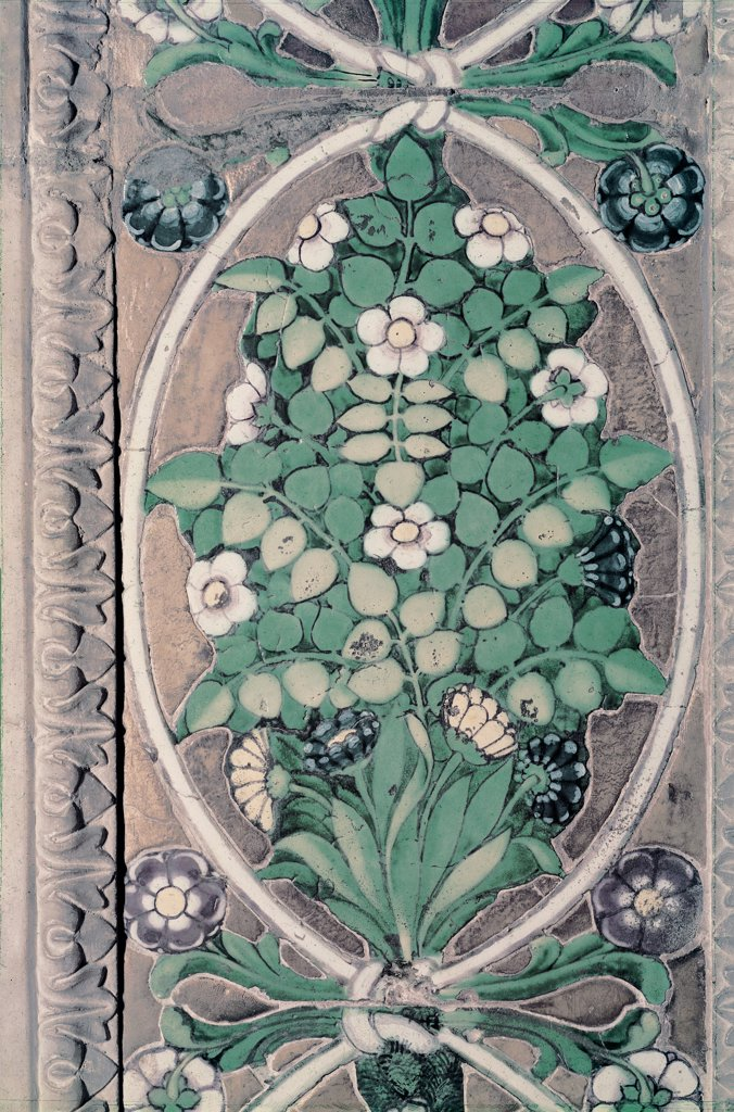 Tomb of Bishop Benozzo Federighi, by Della Robbia Luca, 1455, 15th Century, majolica. Italy, Tuscany, Florence, Santa Trinita Church. Detail decorative frieze ribbons bouquets flowers leaves. : Stock Photo