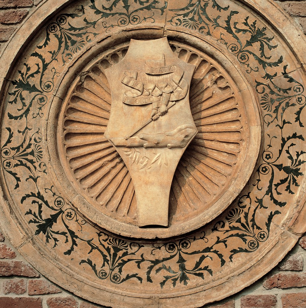 Stock Photo: 1899-31389 Santa Maria delle Grazie church, Milan, by Solari Guiniforte, Donato di Pascuccio di Antonio known as Bramante, 1463, 15th Century, Unknow. Italy, Lombardy, Milan, Corso Magenta, Santa Maria delle Grazie church. Exterior church tribune brick decorative panel carved tondo heraldic coat of arms.