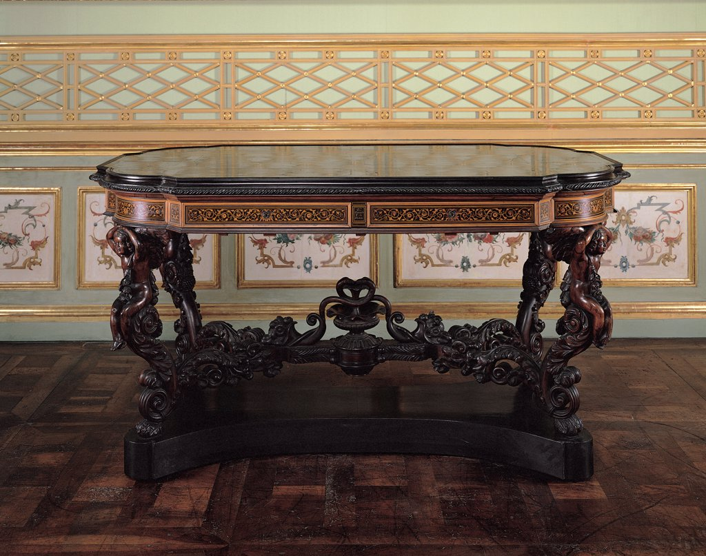 Stock Photo: 1899-31537 Table, by Ciaudo Giuseppe, 1850, 19th Century, mahogany wood, avory inlaid. Italy, Piemonte, Turin, Royal Palace. View. Table rinceaux volutes top decoration putti: cherubs phytomorphic motifs.