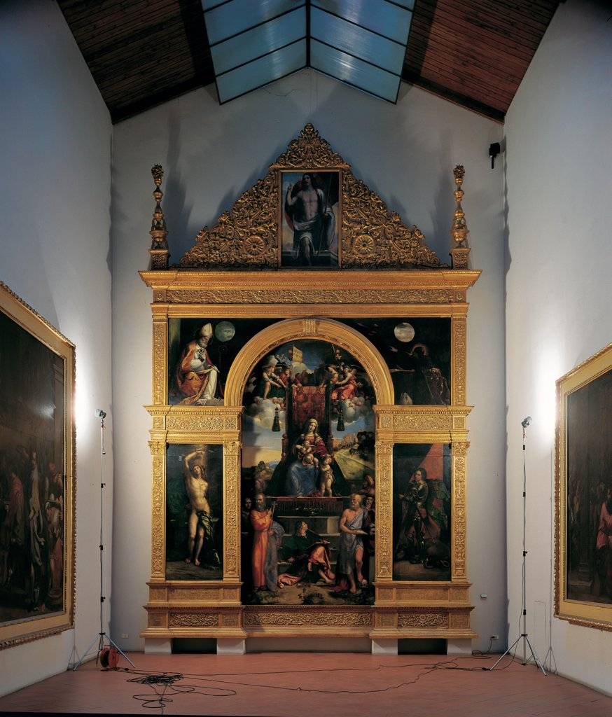 Stock Photo: 1899-31918 Polyptych with Virgin Enthroned and Saints or Polyptych Costabili, by Tisi Benvenuto known as Garofalo, Luteri Giovanni know as Dosso Dossi, 1513 - 1525, 16th Century, oil on board and wood, gilded and carved . Italy, Emilia Romagna, Ferrara, National Gallery of Art. Whole artwork. Polyptych Madonna Virgin Mary throne Infant Jesus: Baby Jesus: Christ Child saints angels Infant St John, John the Evangelist, Sebastian Andrew Jerome Augustine George Ambrose Risen Christ.