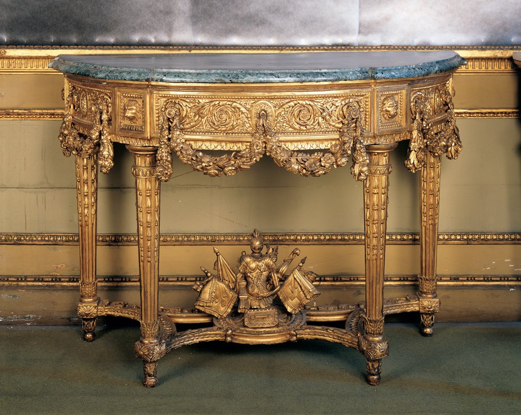 Console table, by Piedmont Work, 1780, 18th Century, wood carved and gilded. Italy, Piemonte, Turin, Royal Palace. Whole artwork. Console table wall table gold oval phytomorphic motifs garlands banners: standards armor. : Stock Photo
