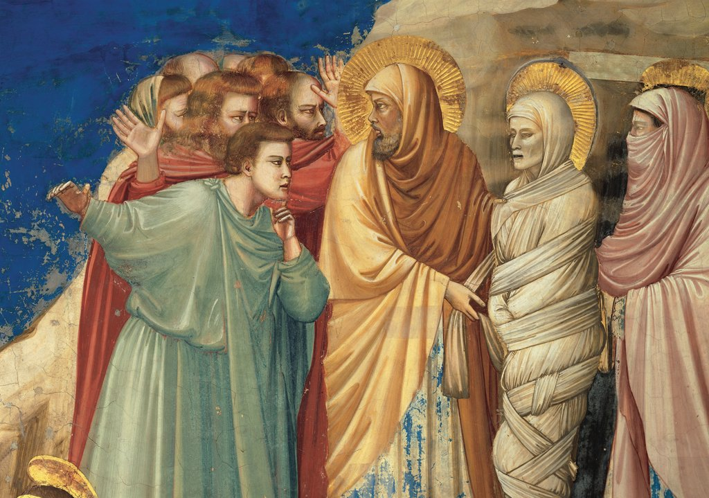 Stories of Christ of The Raising of Lazarus, by Giotto, 1304 - 1306, 14th Century, fresco. Italy, Veneto, Padua, Scrovegni Chapel. Scenes from the Life of Christ of Raising of Lazarus Jesus and Lazarus group bystanders rays halos. aureoles yellow gold pink red green tones. hues brown rocks blue background. : Stock Photo