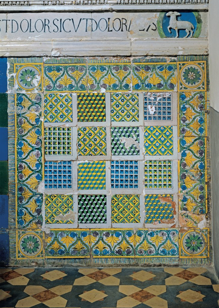 Tiles of the Stigmata Chapel, by school Della Robbia, 15th Century, glazed polychrome terracotta. Italy, Tuscany, Arezzo, La Verna Sanctuary, Stigmata Chapel. Detail. Tiles floral motifs geometries yellow blue green. : Stock Photo