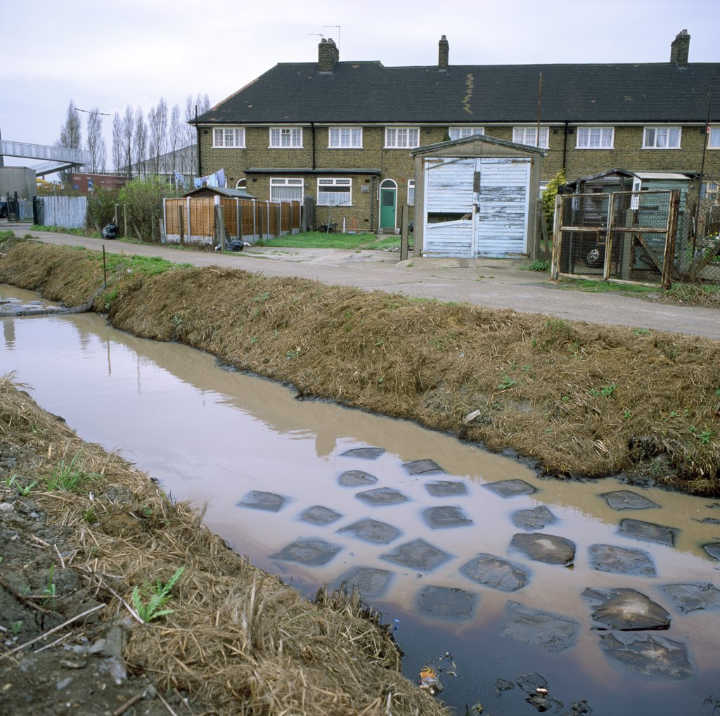 Stock Photo: 1899-34271 Stream polluted by leaking chemicals from local industry in urban area, Barking, London 1992.
