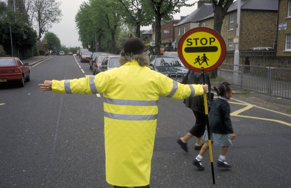 Lollypop lady at school crossing, London, UK.  : Stock Photo