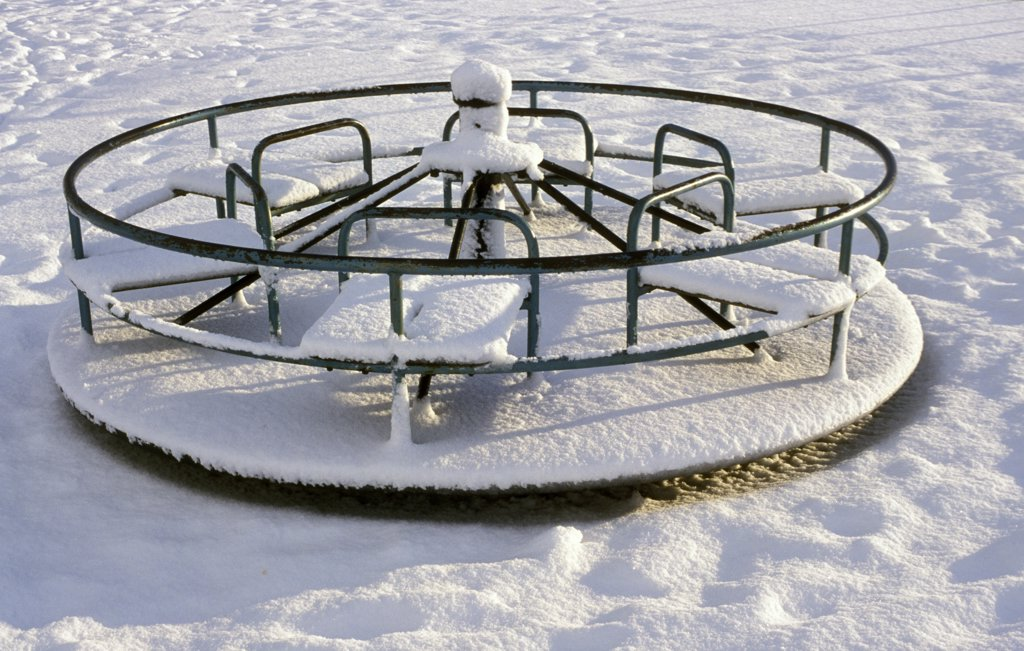 Stock Photo: 1899-34427 Snow covered playground roundabout Aberdeenshire, Scotland.
