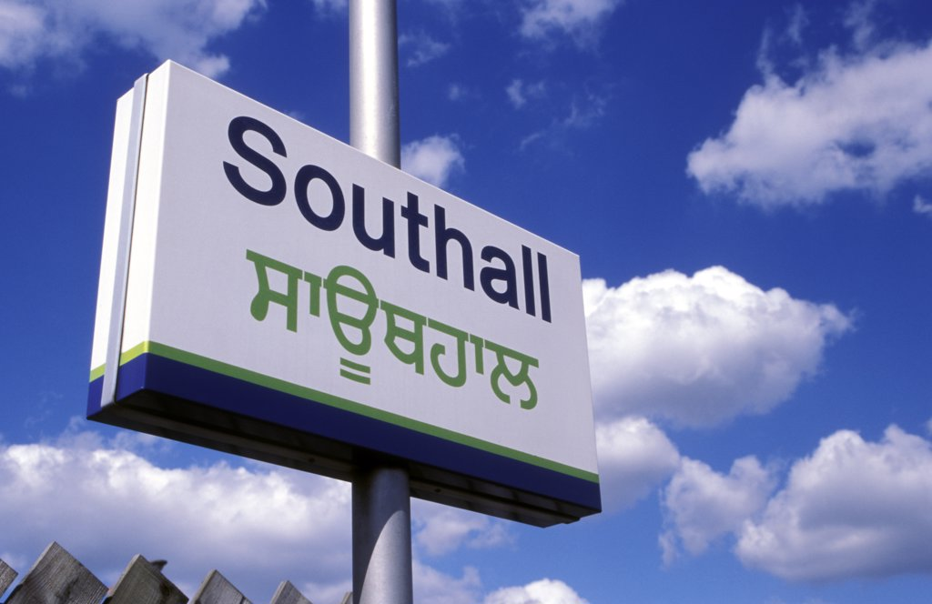 Stock Photo: 1899-34468 Southall British Rail station, sign in both English & Punjabi. Southall is a predominantly Sikh community West London UK.