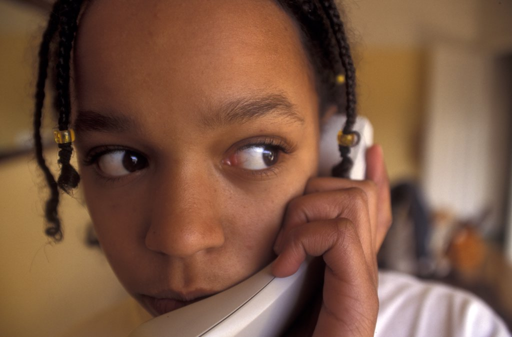 Teenager talking on the telephone.  : Stock Photo