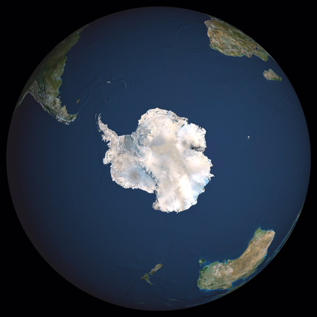 Stock Photo: 1899-34583 Globe South Pole, True Colour Satellite Image. Earth. True colour satellite image of the Earth, centred on Antarctica. The South Pole is at centre. Antarctica is a frozen continent, permanently covered in snow and ice. Surrounding Antarctica are the waters of the Southern Ocean, mixing with the Atlantic Ocean (upper centre), the Pacific Ocean (lower left) and the Indian Ocean (centre right). Around the edge of the hemisphere is New Zealand (lower centre), Australia (lower right), and the souther